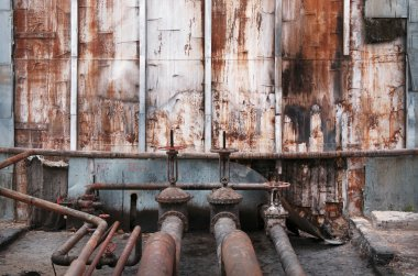 old pipes and valves at an oil terminal