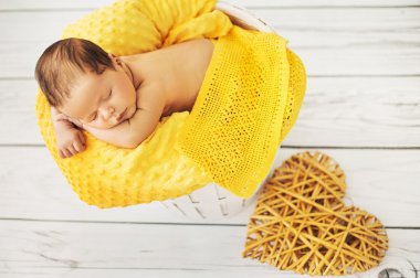 Cute toddler sleeping on a yellow blanket stock vector