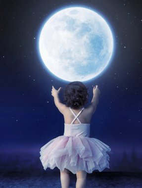Little baby girl reaching to the moon