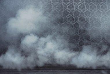 Old vintage room filled with dense smoke