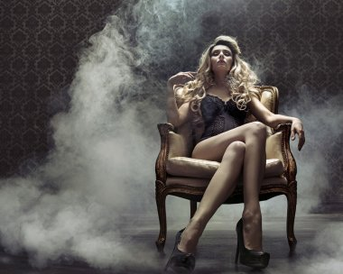 Sensual blond lady in the retro grunge place