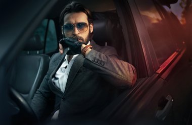 Elegant handsome man driving a car