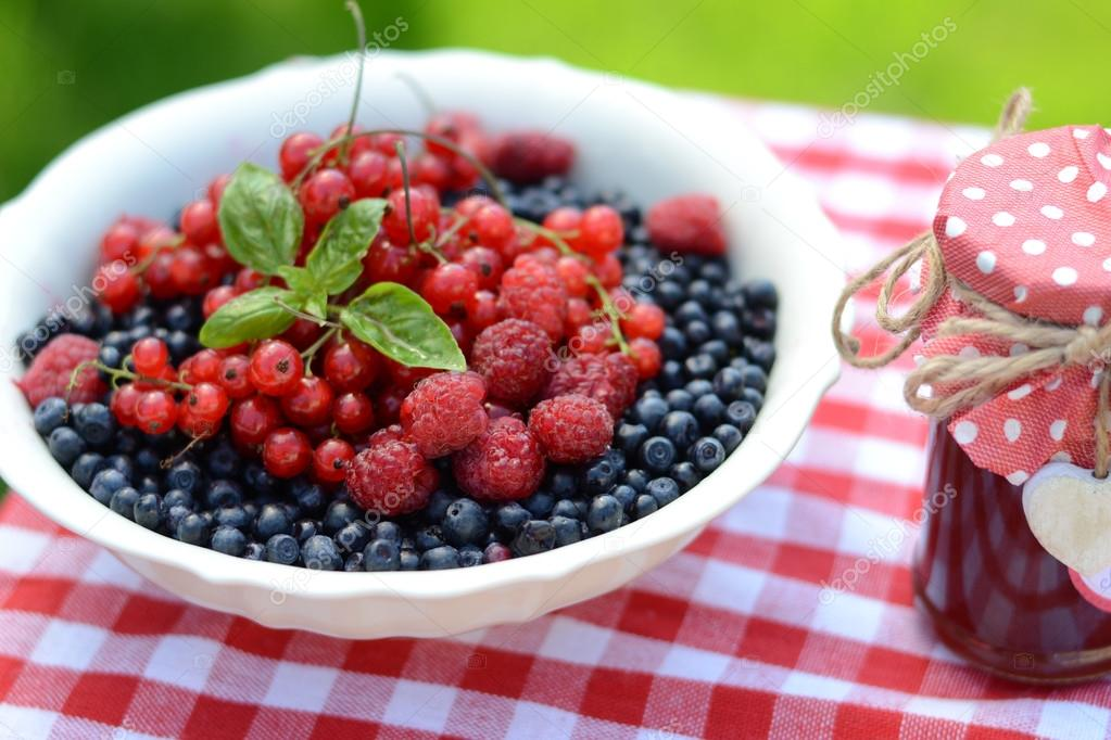 Fresh berries and raspberry jam, served in the garden