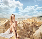 Sensual blonde with the beautiful landscape behind