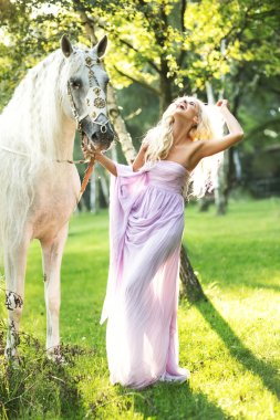 Laughing lady walking with horse