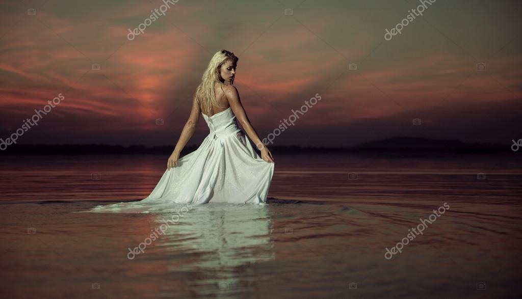 Sensual lady dancing in the water