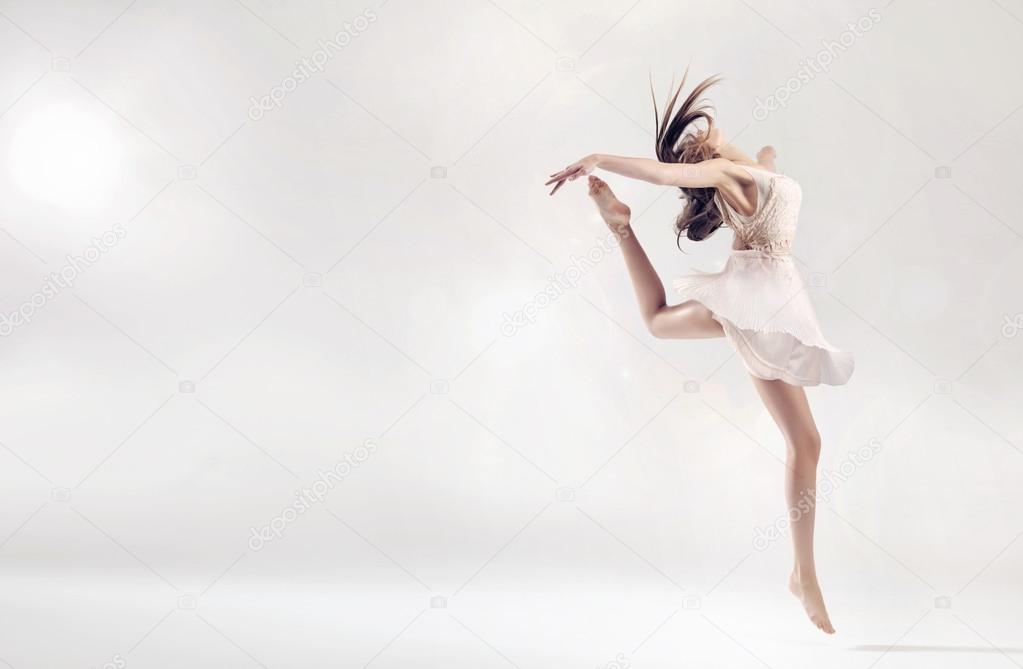 Pretty female ballet dancer in jump figure