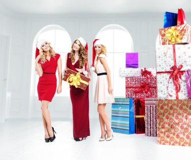 Three attractive girls with lots of gifts