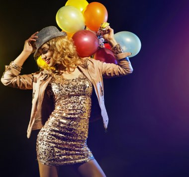 Joyful partying lady with colorful balloons