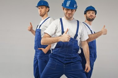 Three optimistic employees during the work