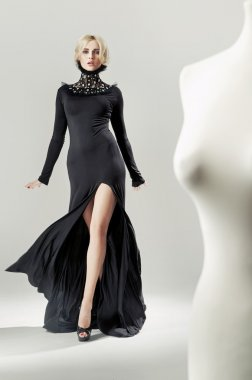 Shapely, alluring blond lady in black gown