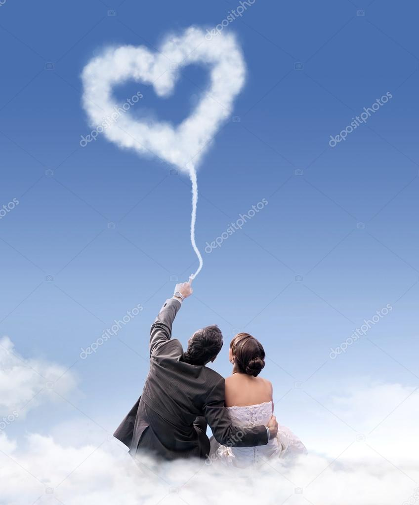 Just married couple sitting on the cloud