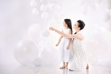 Mom and daughter playing balloons