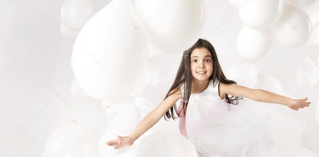 Cute little girl playing balloons