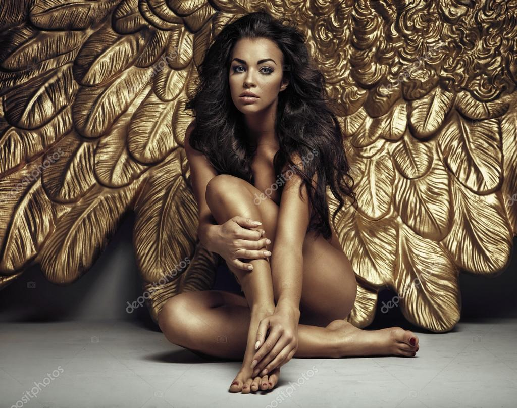 Portrait of a cute angel with gold wings