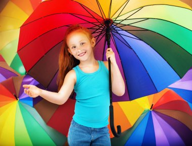 Portrait of a redhead child with an umbrella stock vector