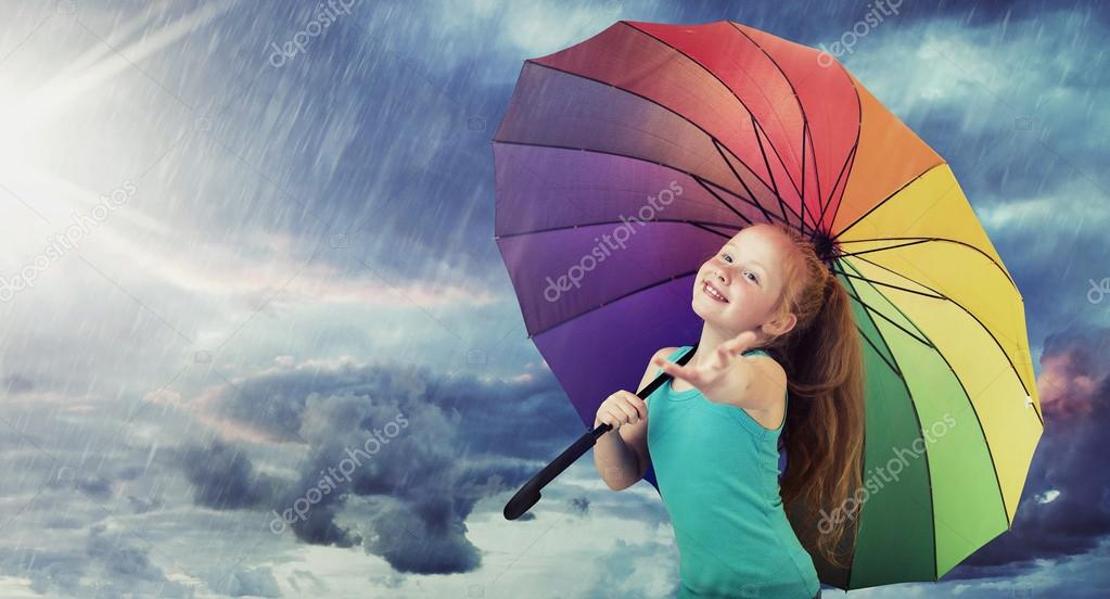 Cheerful girl with a colorful umbrella