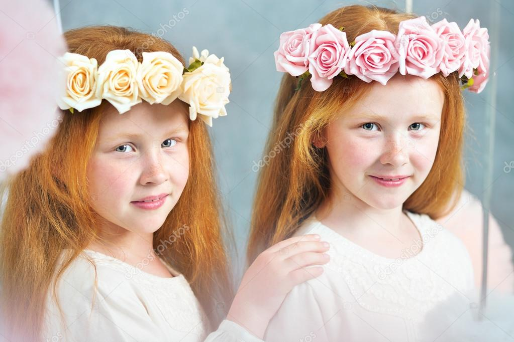 Two redhead sisters posing together