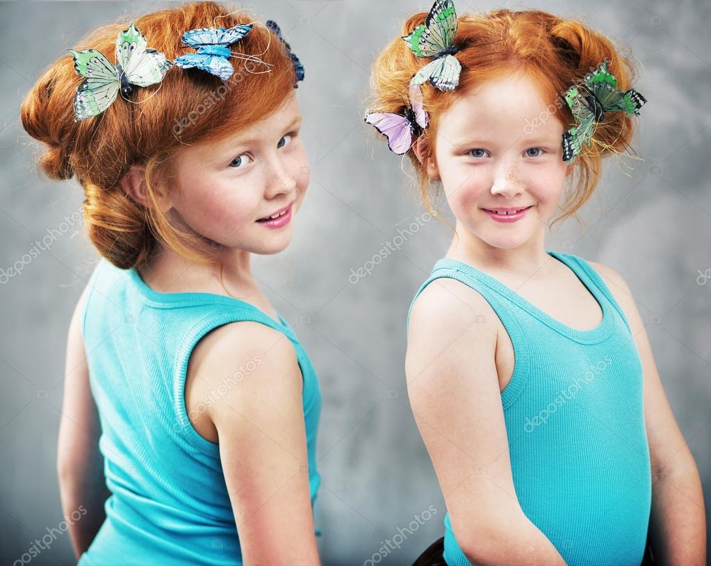 Two ginger twins with butterflies in haircut