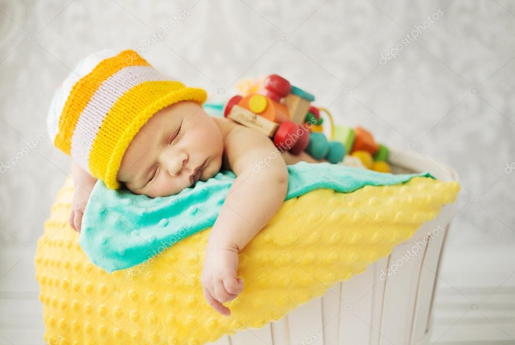 Cute baby sleeping in the basket