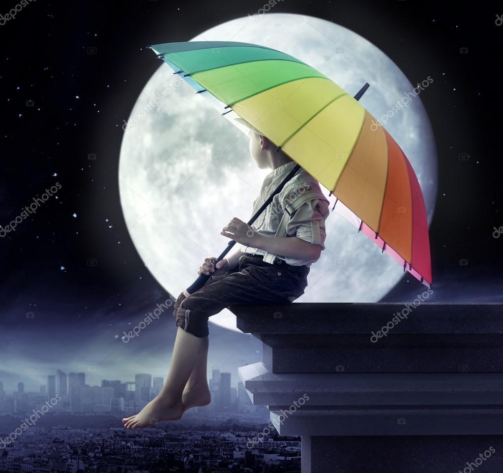 Little boy holding an umbrella