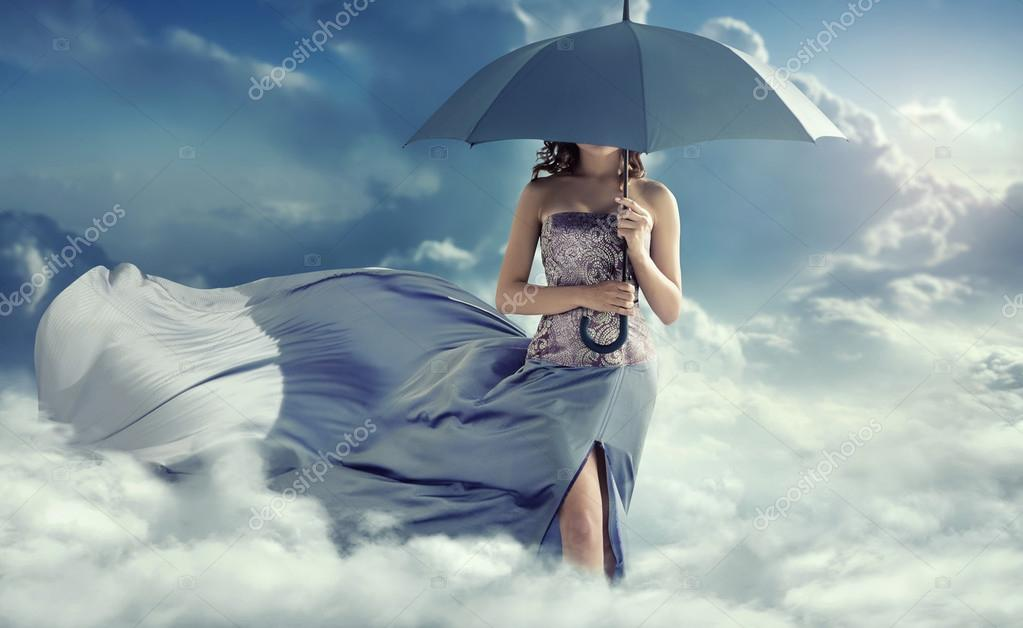 Attractive woman walking on the clouds