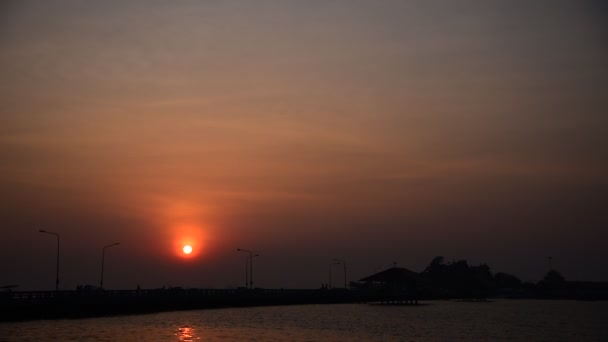 Sunset sky with silhouette of bridge and Kho Loi island, Sriracha, Chonburi, Thailand