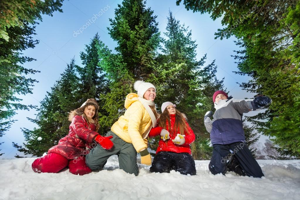 Kids competes in throwing snowballs