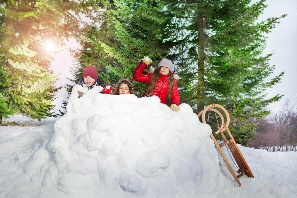 Children playing snowballs