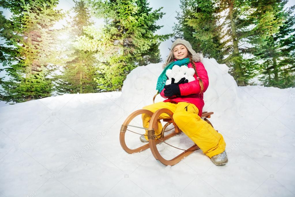 Girl sitting on the sledge
