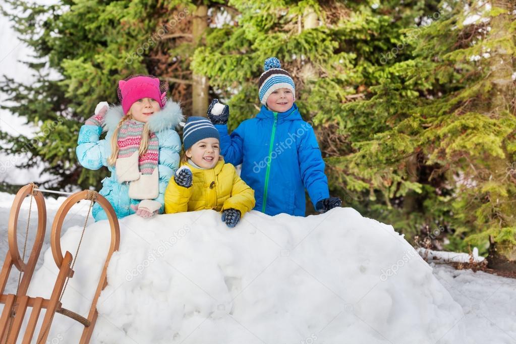 little children in snow fortress
