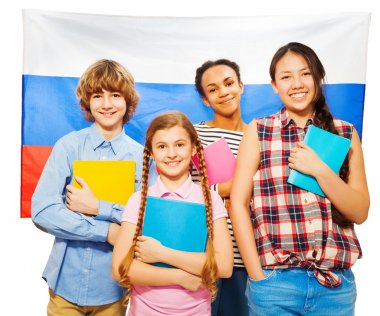 students standing against Russian flag