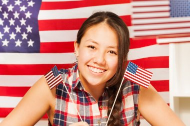 Asian girl with flags of USA