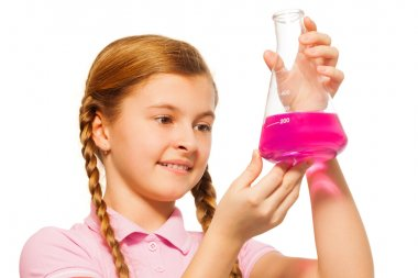 Young chemist pouring reagent in glass