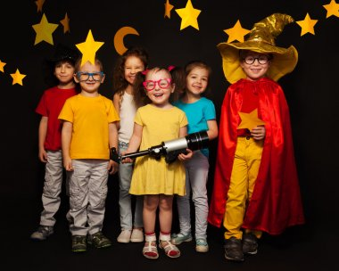 boys and girls in stargazers costumes