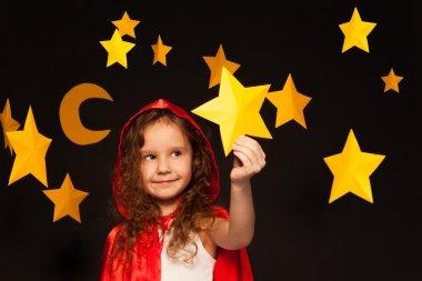 Little dreamer holding shooting star