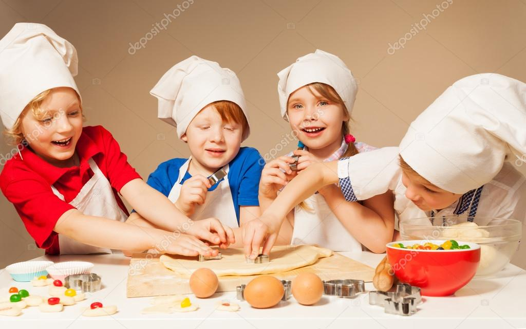 Four smiling bakers