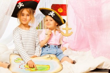 Two little girls playing pirates