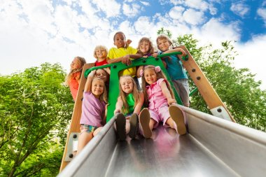 Many kids on playground chute
