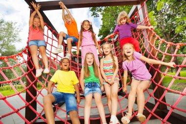 Happy kids on net ropes
