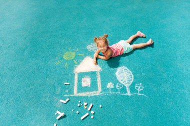 Little girl drawing chalk image