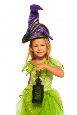 Beautiful little girl with long blond hair standing in Halloween costume holding lantern isolated on white background stock vector