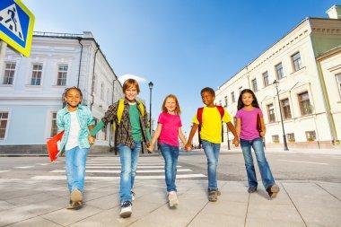 Schoolchildren walking together