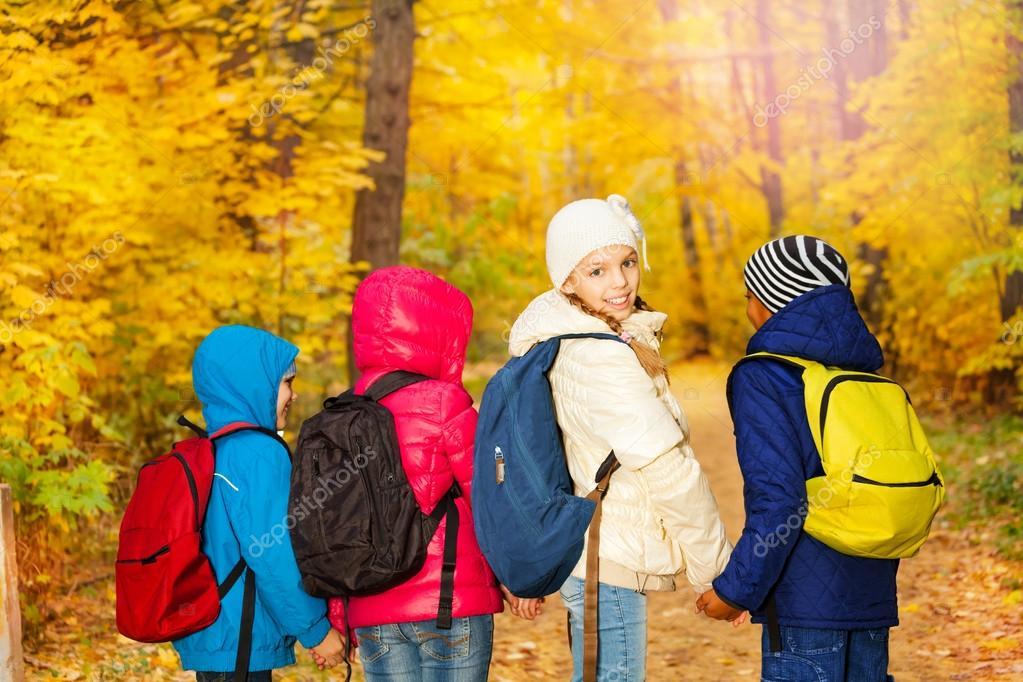 Children wearing rucksacks