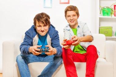 friends hold joysticks