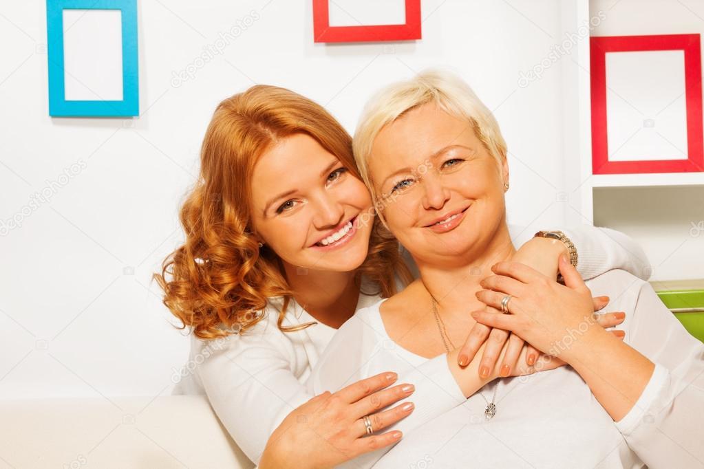 Happy daughter and eldery mother