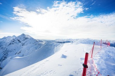 Beautiful Caucasus mountains with fence during daytime in Sochi ski resort Krasnaya polyana, Russia stock vector