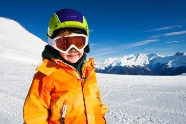 Boy wearing ski mask on ski-track