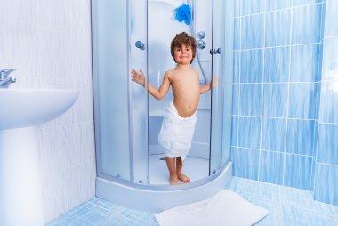 Little boy in hotel shower