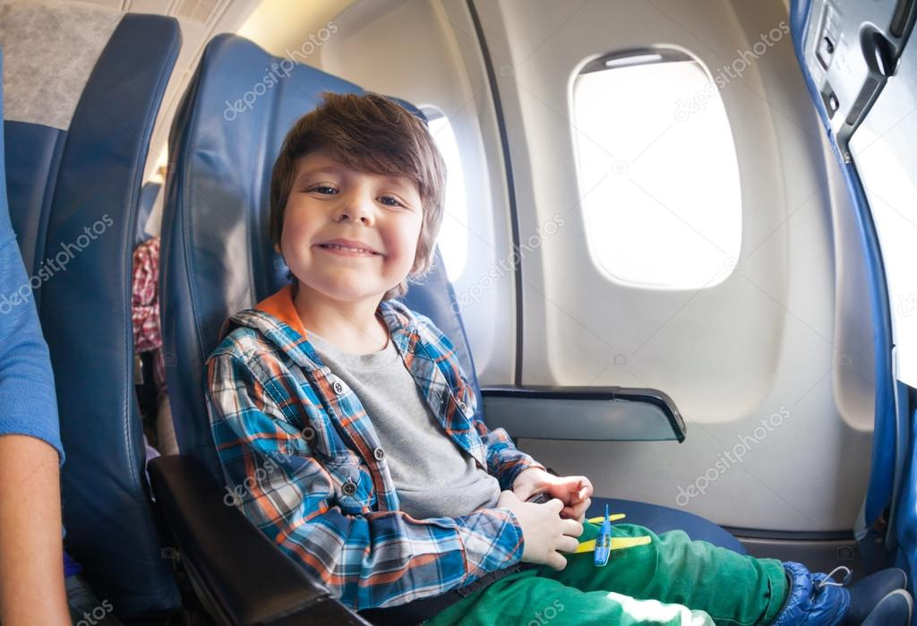 Little boy in airplane seat